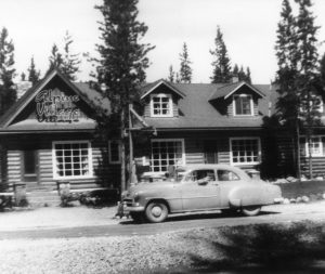 Exterior of Alpine Village Jasper with old car out front