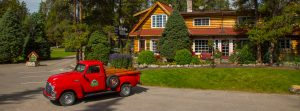 Exterior of Alpine Village Jasper with red truck out front
